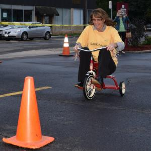 Brandy Roy pedals for the Community Bank N.A. team at the 15th annual Tricycle Race to benefit United Way of the Southern Tier.